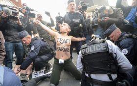Выборы во Франции: задержаны активистки FЕMEN в масках Путина, Ле Пен и Асада