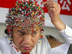 В честь Олимпиады китаец воткнул в себя 2008 иголок