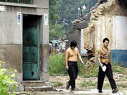 Общественные туалеты в Пекине оставят без дверей