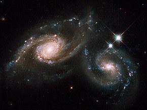 """Телескоп """"Хаббл"""" представил фото сливающихся галактик"""