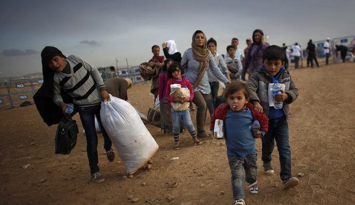 У границы с Турцией вдвое выросло число беженцев из Сирии