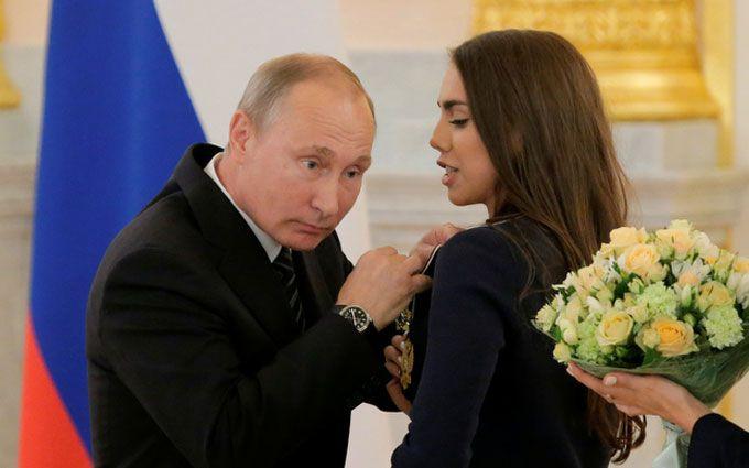 Путін шокував поглядом, торкаючись до грудей чемпіонки: опубліковано фото