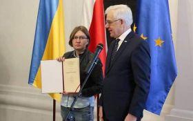 За людську гідність: глава МЗС Польщі вручив престижну нагороду сім'ї Олега Сенцова