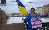 У Санкт-Петербурзі побили активіста з українським прапором: з'явилися фото і відео