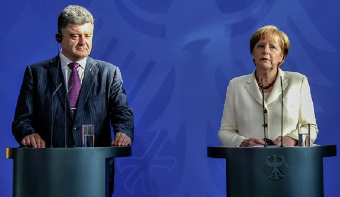 ЕС не снимет санкции с РФ до полного выполнения минских соглашений - Меркель