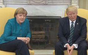 У Трампа пояснили його дивну поведінку на зустрічі з Меркель