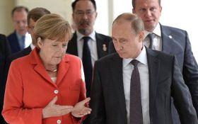 Путин и Меркель обсудили Донбасс и убийство Захарченко