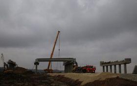 Оккупанты завершили очередной этап строительства Крымского моста: новые фото