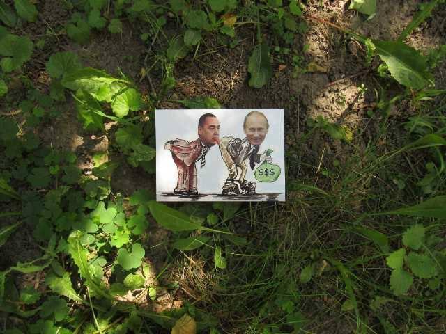 Луганські партизани провели диверсію з портретом Путіна: з'явилися фото (1)