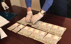 Чиновников из Фонда госимущества в Киевской области поймали на взятке: появились фото