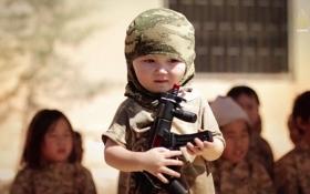 Боевики ИГИЛ учат детей убивать: раскрыты шокирующие подробности