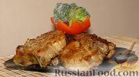 Фото к рецепту: Свиной стейк на ребрах